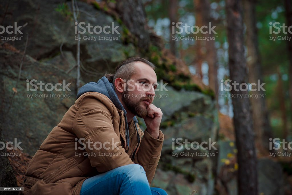 Man is sitting in forest and dreams. royalty-free stock photo