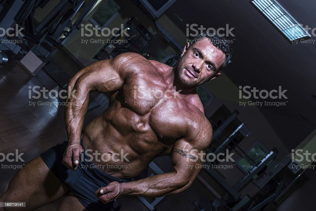 Man is smiling and looking at the camera in gym royalty-free stock photo