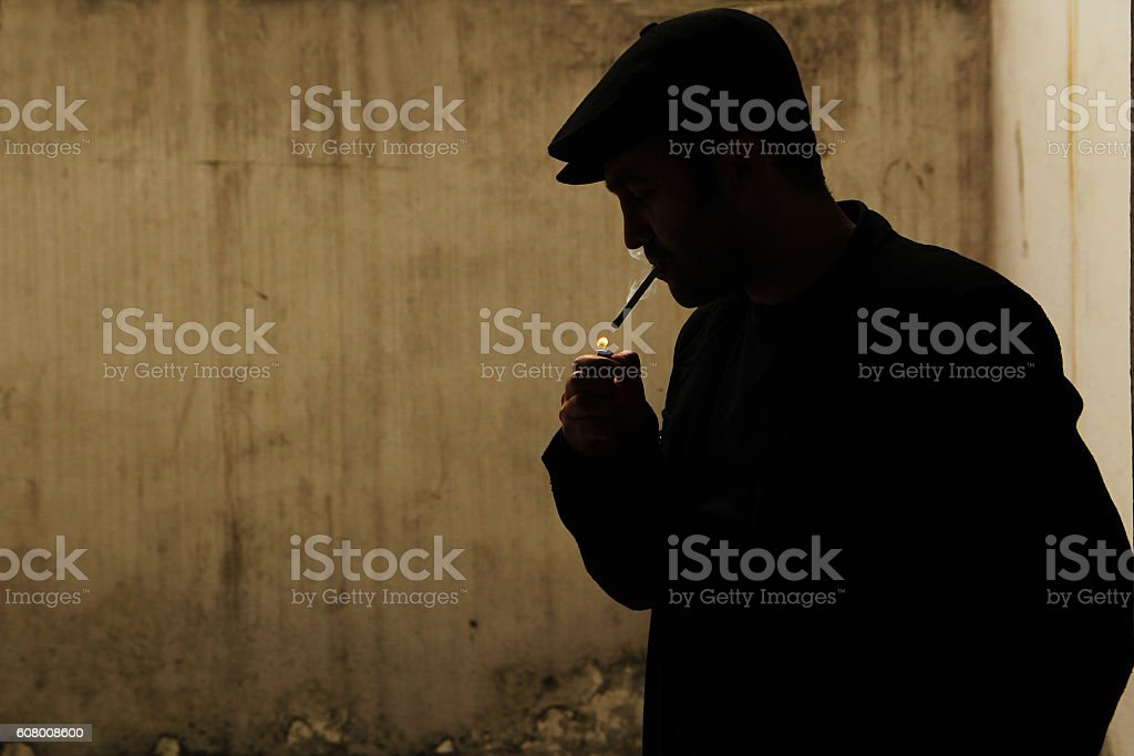 man is smoking stock photo
