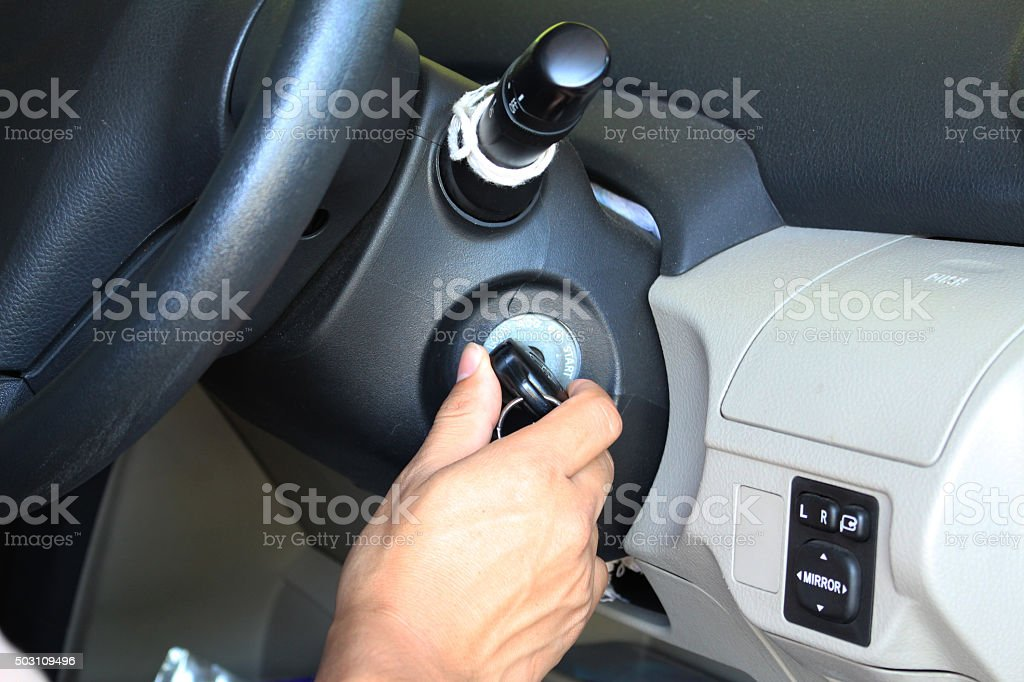 Man is starting his car stock photo