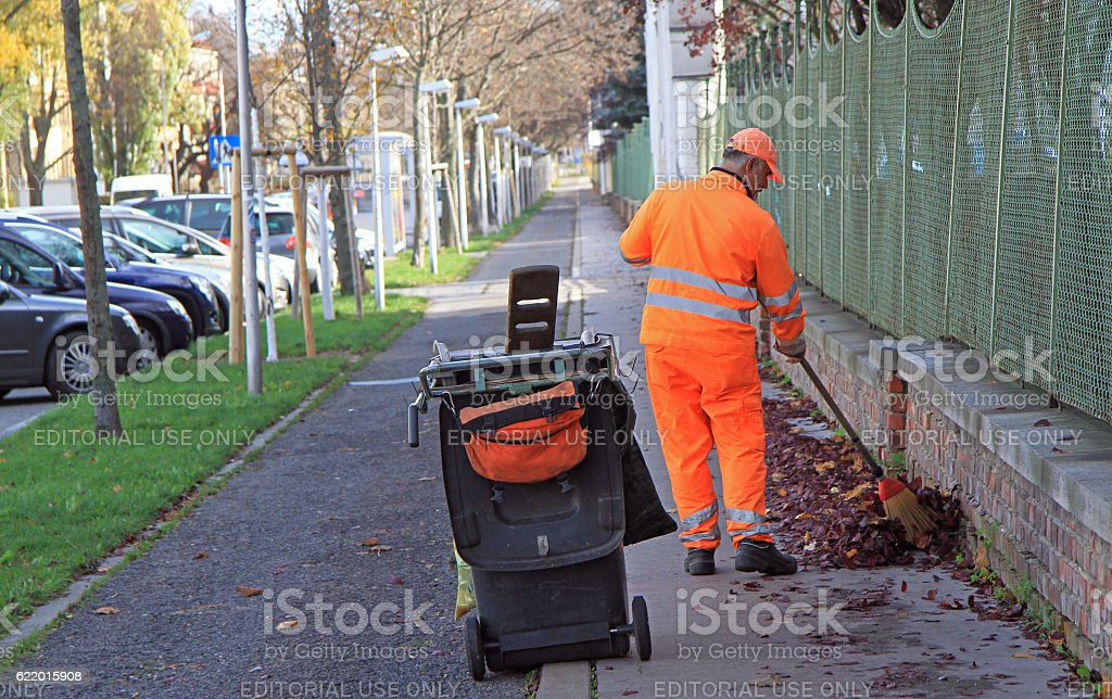 man is sweeping outdoor in Vienna, Austria stock photo