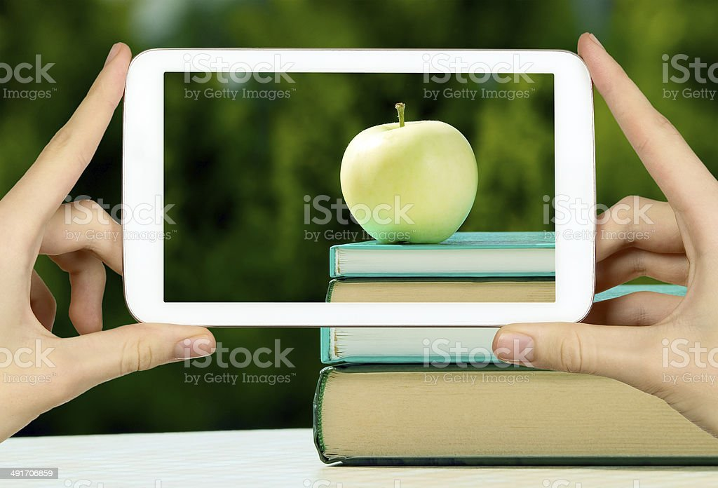 Man is taking photo of apple stock photo