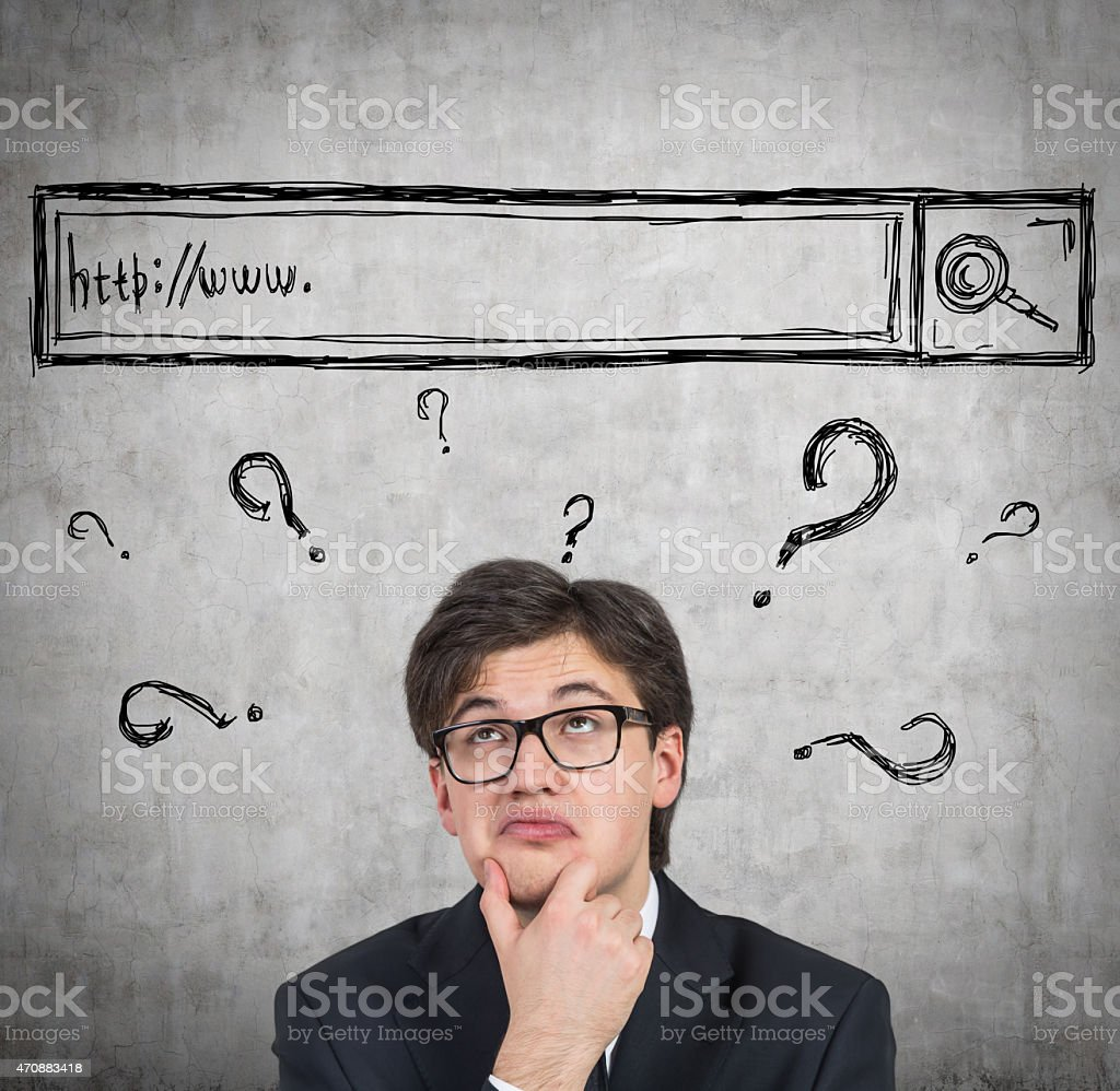 man is trying to find some answers in the internet. stock photo