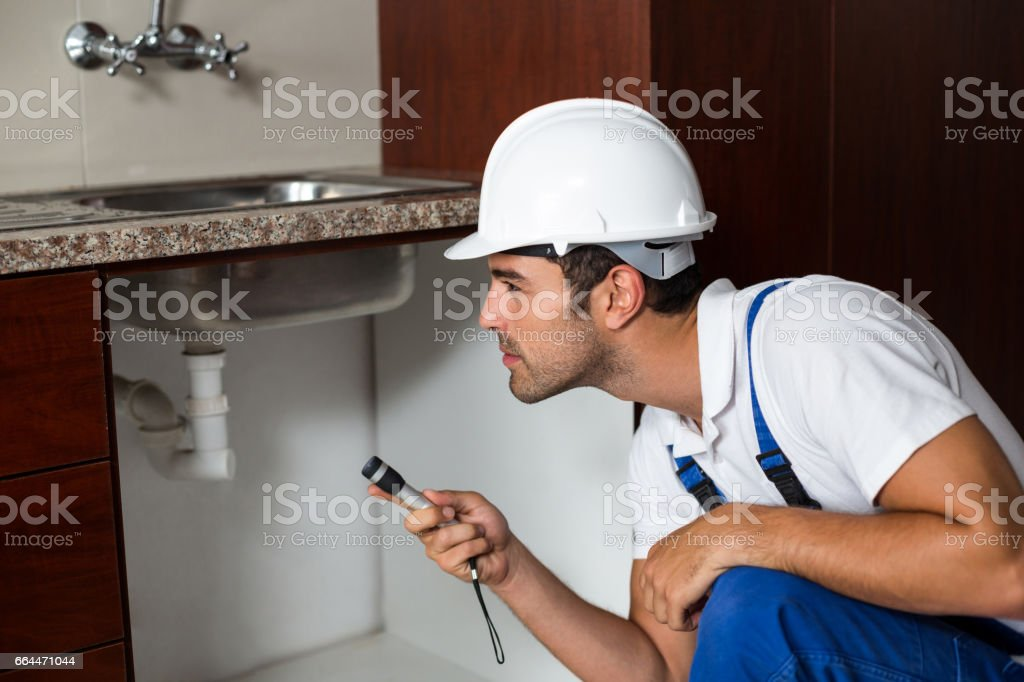 A Man is using a torch in kitchen stock photo