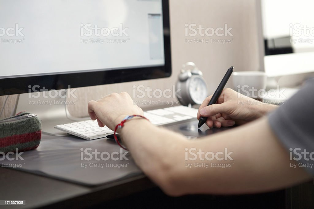Man is using graphics tablet stock photo