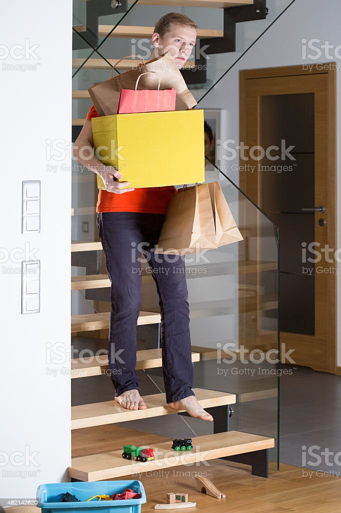 Man is walking down the stairs stock photo