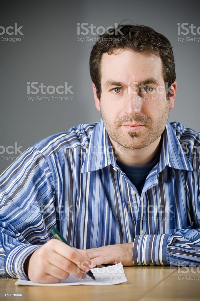 Man is writing- series royalty-free stock photo