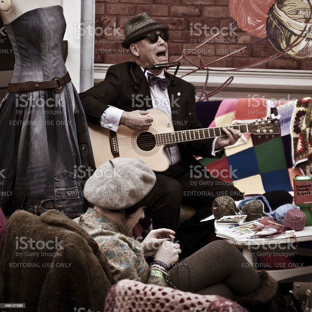 Man jamming on a guitar, Goodwood Vintage Festival. stock photo