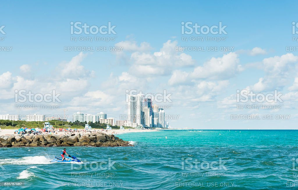 Man Jet Skiing the Tropical Ocean Waters in Miami Florida stock photo