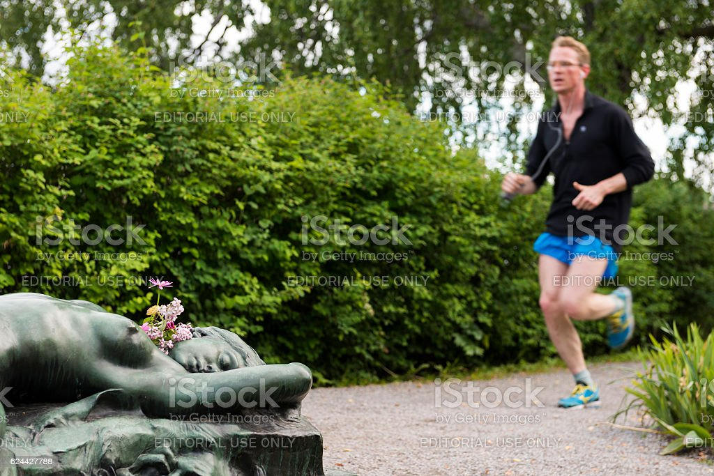Man jogging at Djurgården in Stockholm, Sweden stock photo
