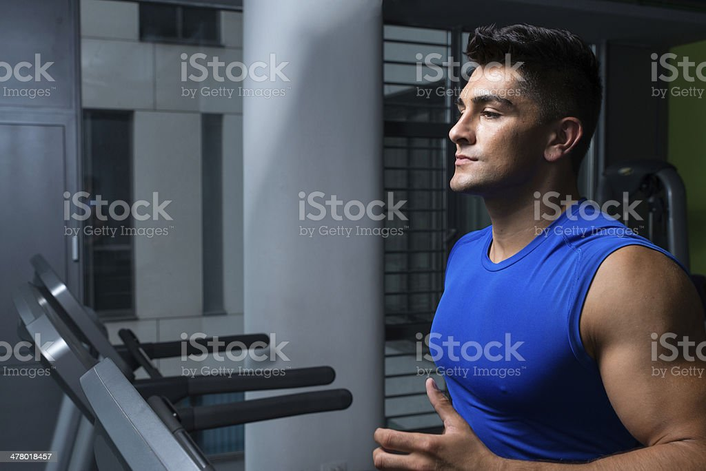 Man jogging in a gym royalty-free stock photo