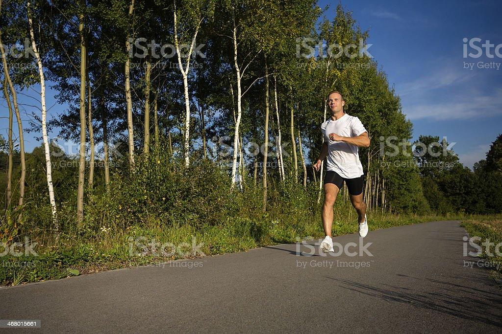 Man jogging in park stock photo