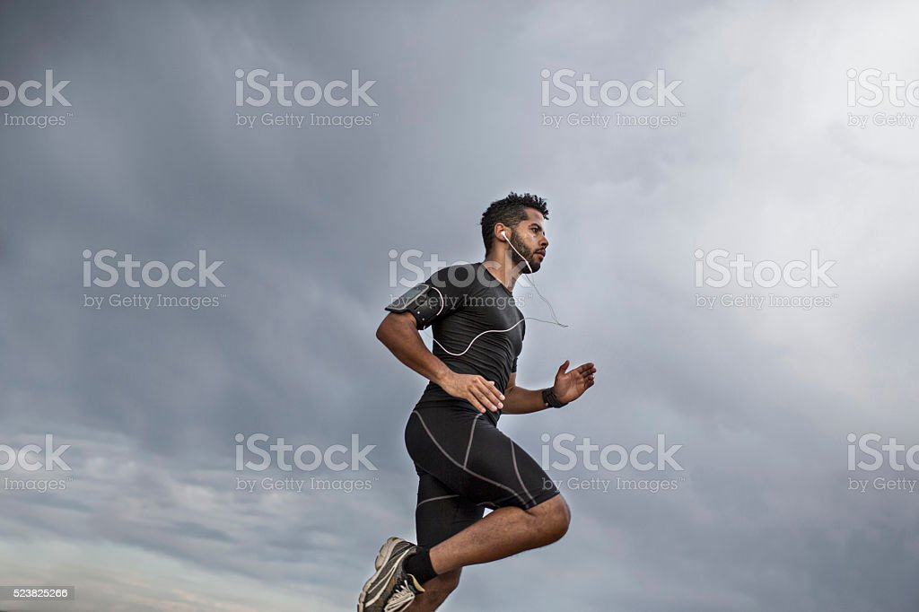 Man jogging in the evening stock photo