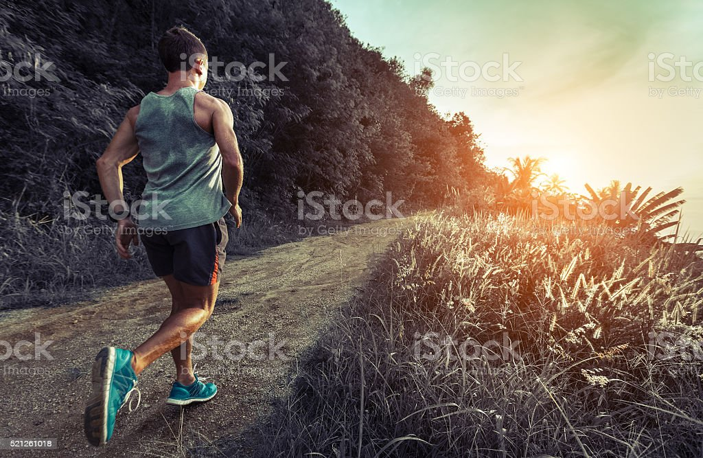 Man jogging on the road stock photo