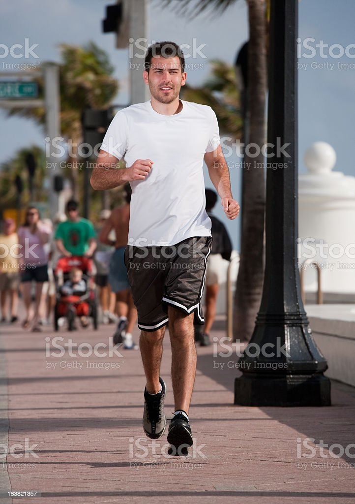 man jogging on the strip in Ft. Lauderdale Beach royalty-free stock photo