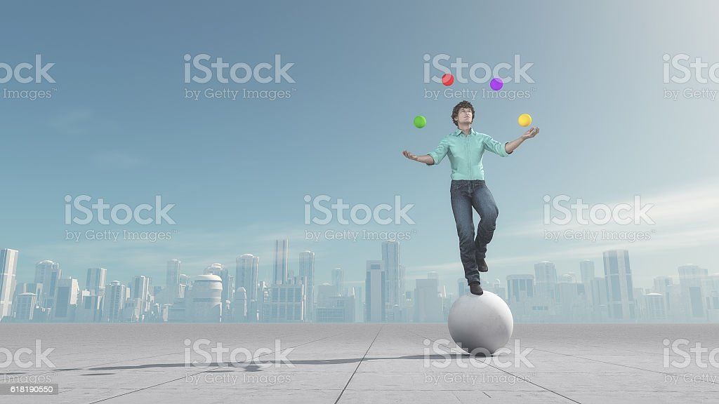 Man juggles the ball in balance stock photo