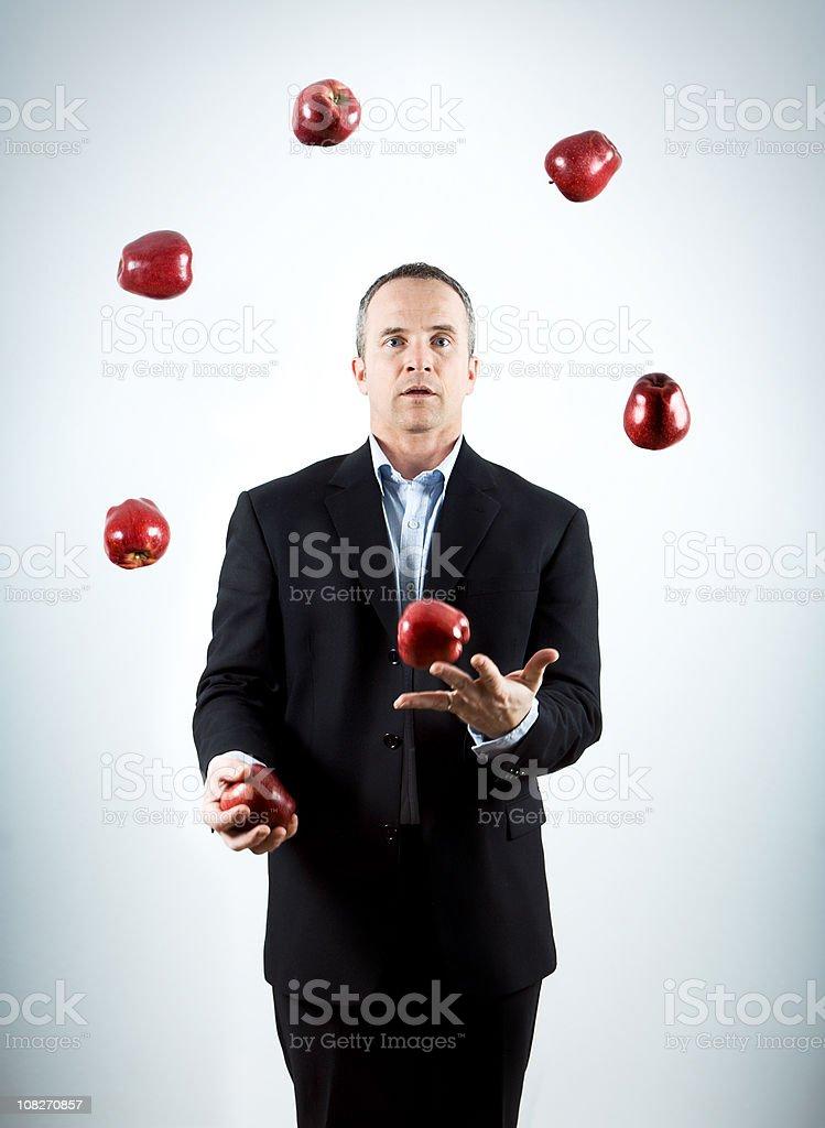 Man Juggling Apples stock photo