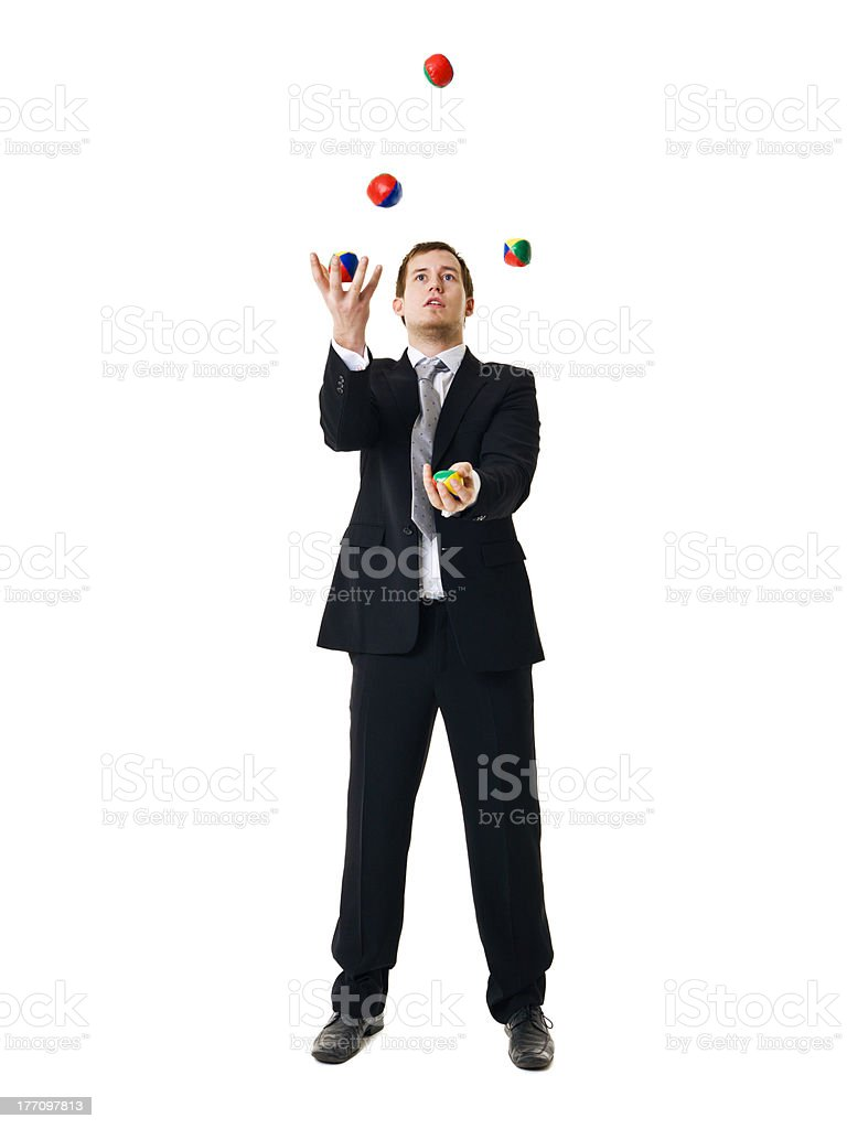 Man juggling on white background stock photo