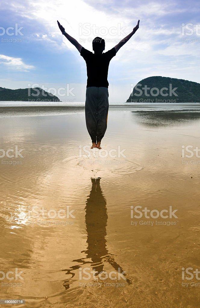 Man jump on beach stock photo