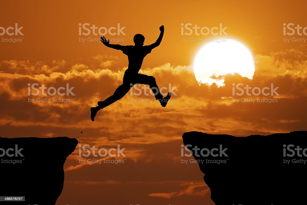 Man jump through the gap. stock photo