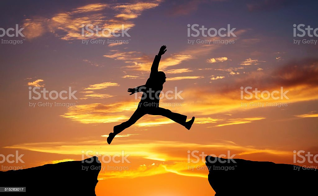 Man jump through the gap stock photo