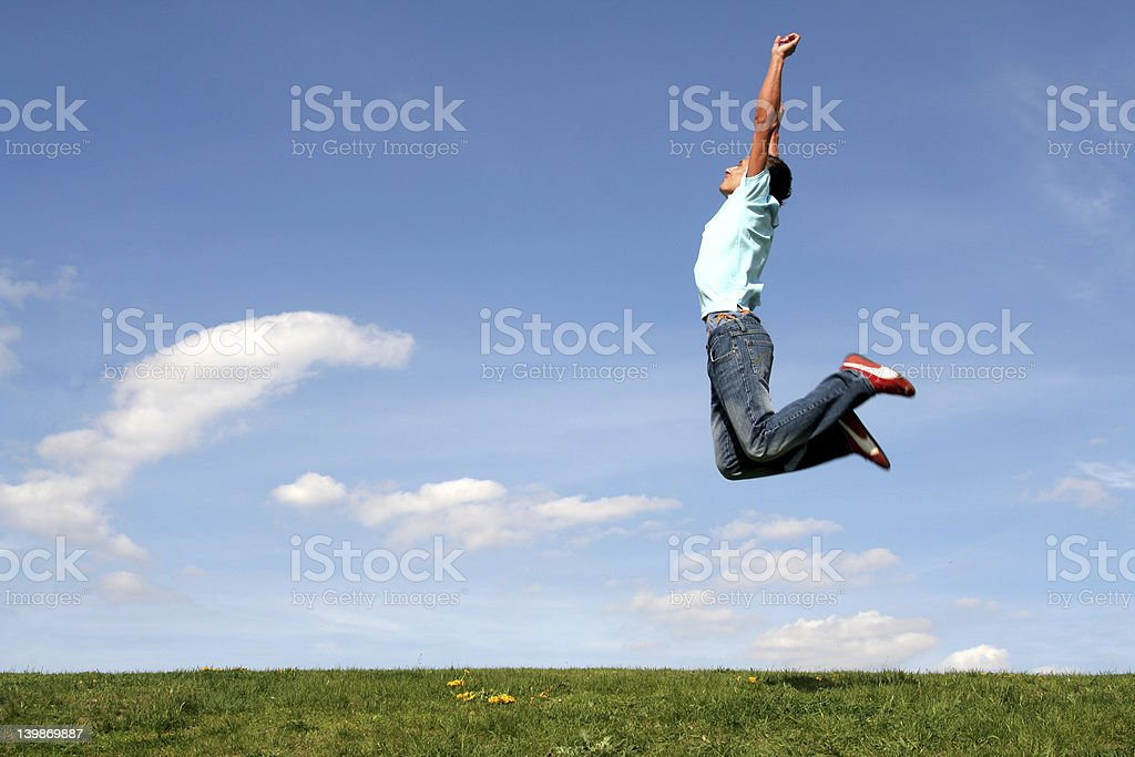 Man jumping against blue sky royalty-free stock photo