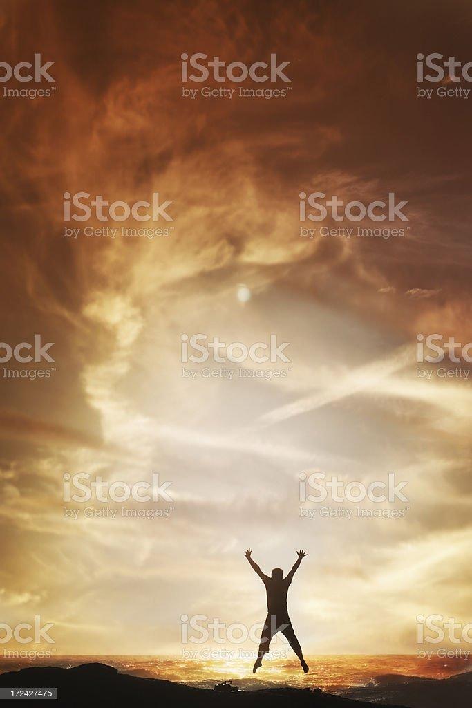 Man jumping at sunset royalty-free stock photo