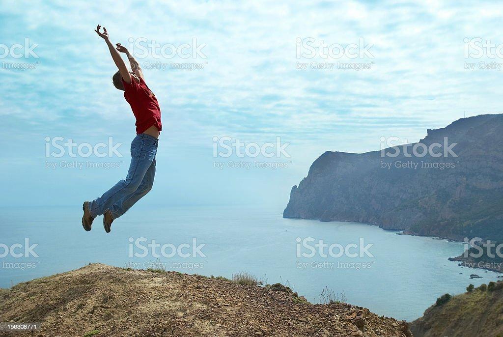Man jumping cliff royalty-free stock photo