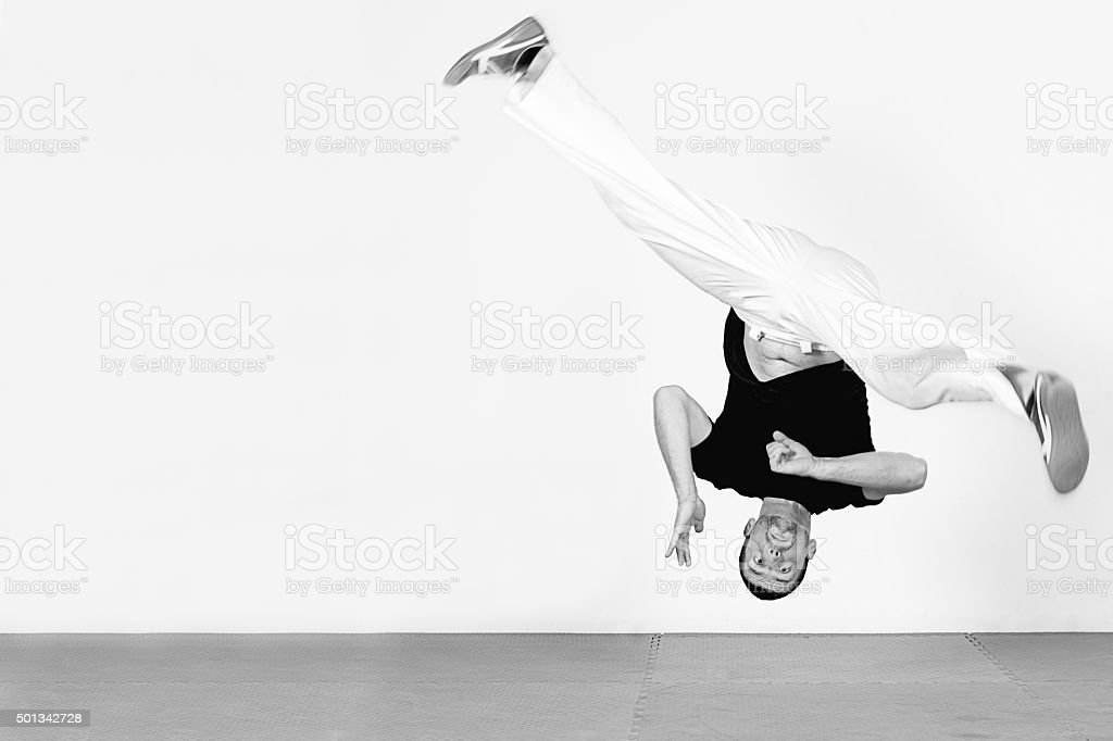 Man jumping, dancing capoeira. Black and white stock photo