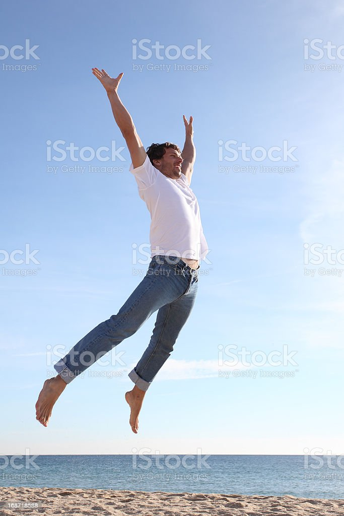 Man jumping happy in the beach royalty-free stock photo