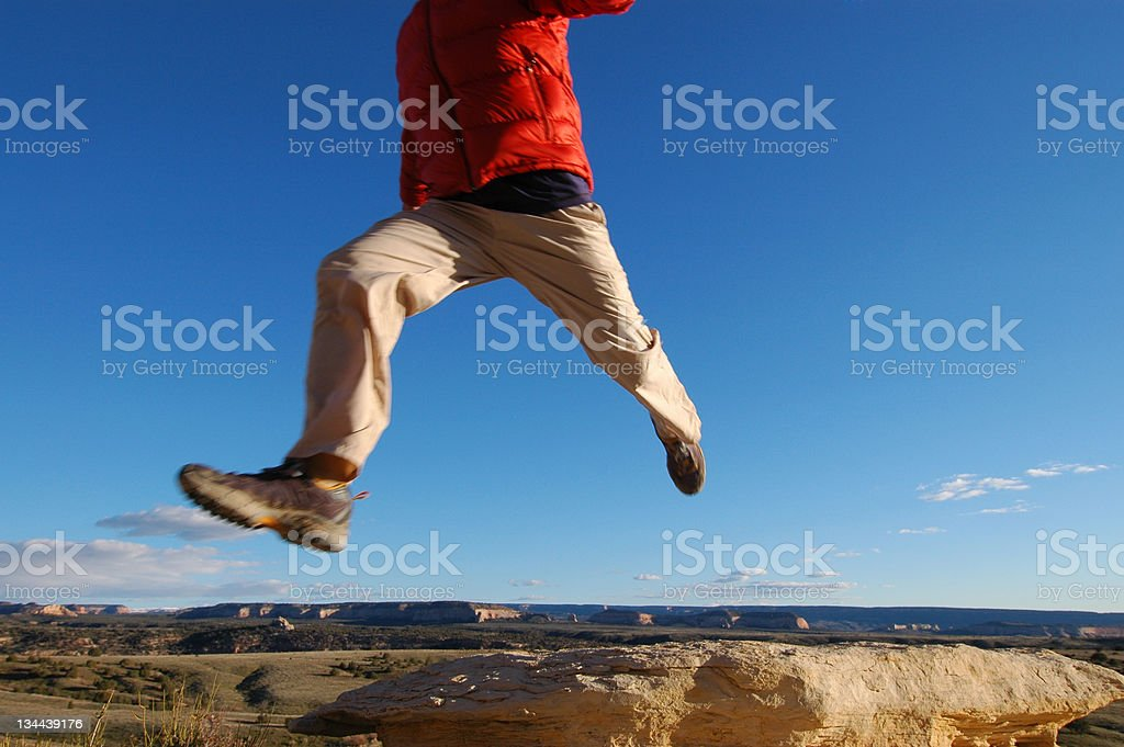 Man Jumping in Air Across Blue Sky royalty-free stock photo