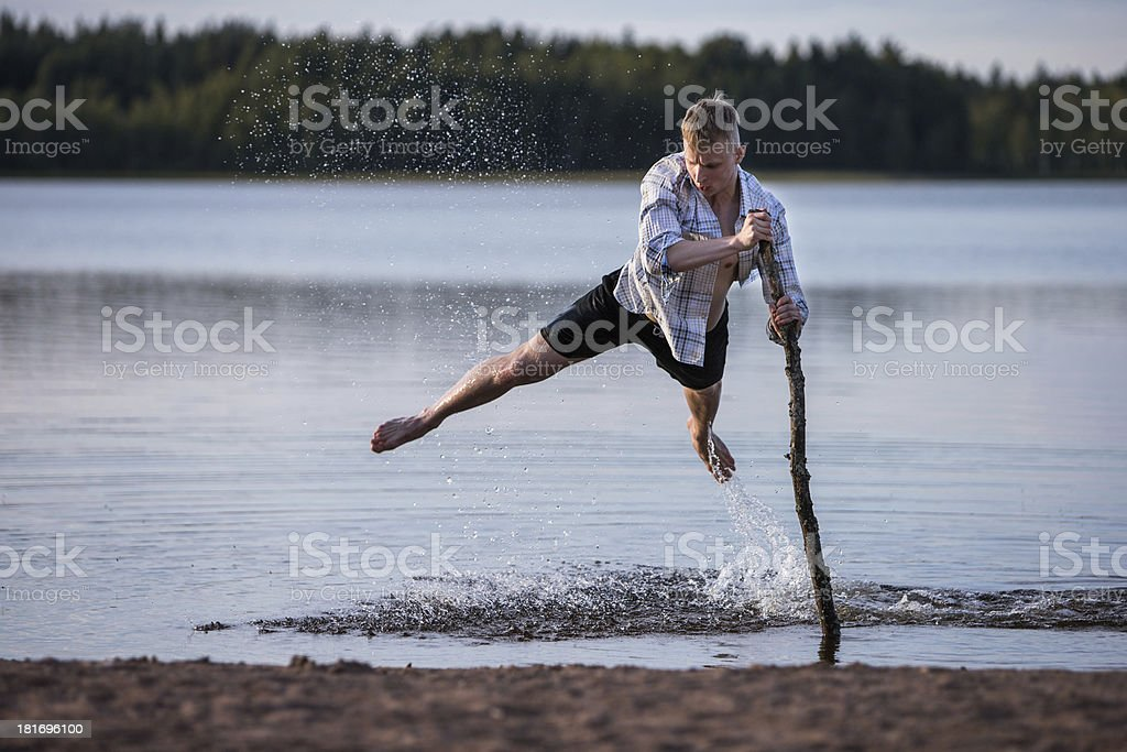 Man jumping in shallow water royalty-free stock photo
