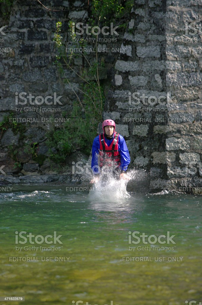 Man jumping in to the river royalty-free stock photo