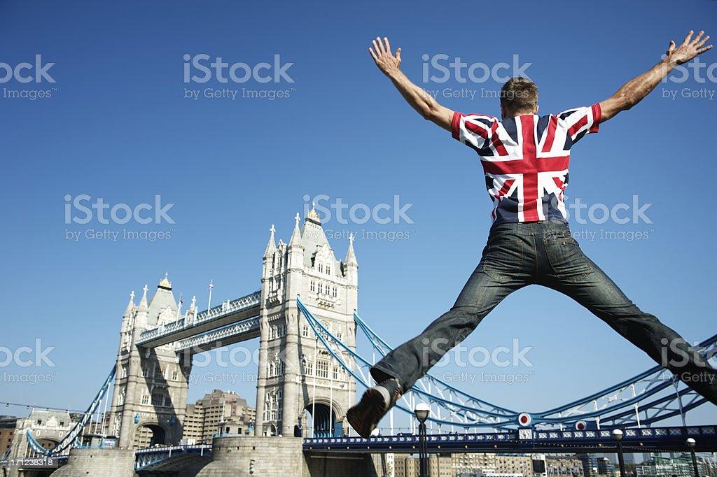 Man jumping in UK Union Jack flag shirt royalty-free stock photo