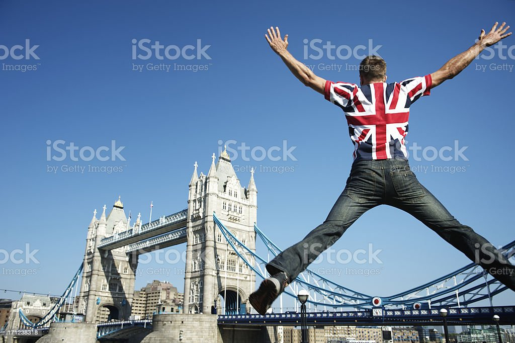 Man jumping in UK Union Jack flag shirt stock photo