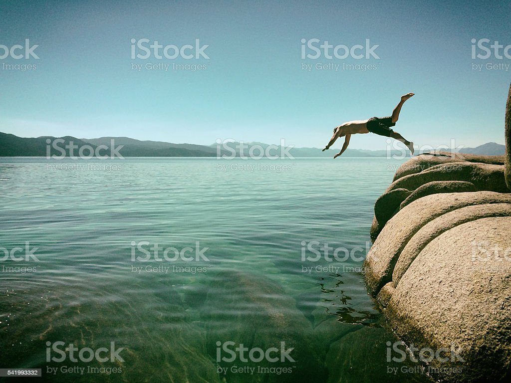 Man jumping into Lake Tahoe, California stock photo