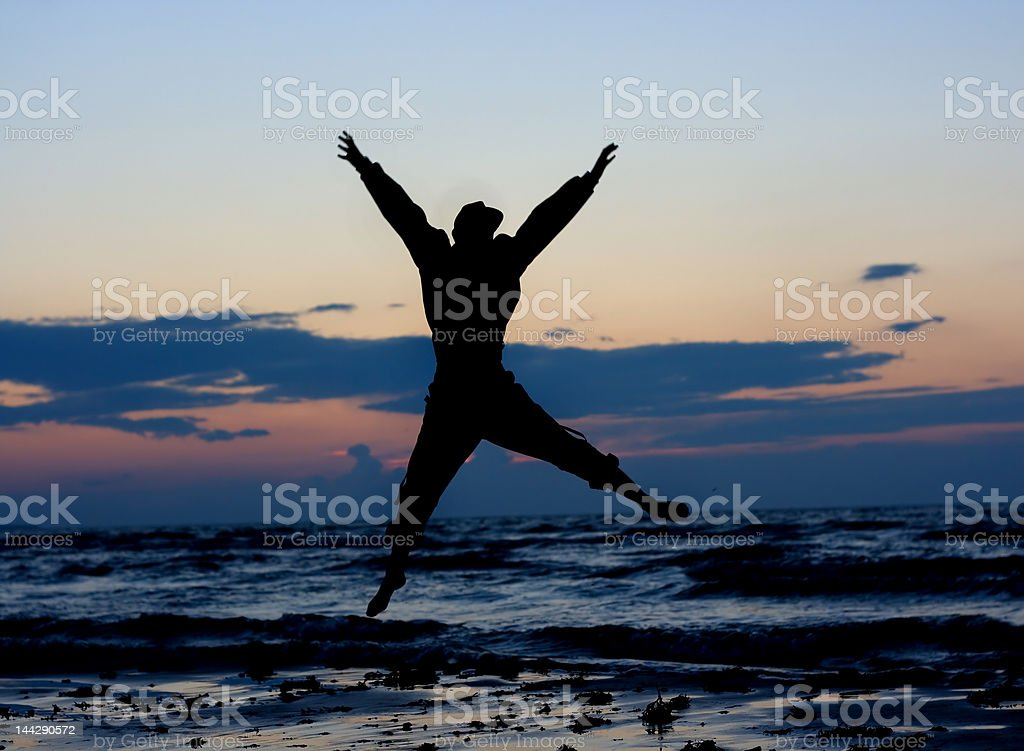 Man jumping near sea. royalty-free stock photo