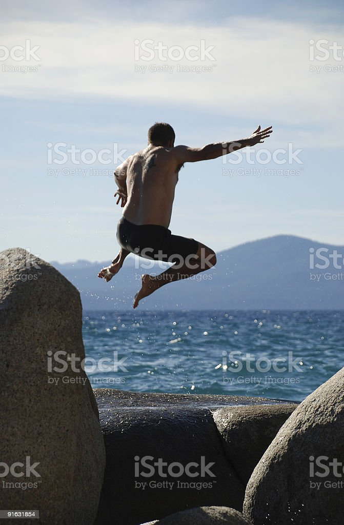 Man Jumping off Rock royalty-free stock photo