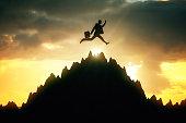 Man jumping on mountain top
