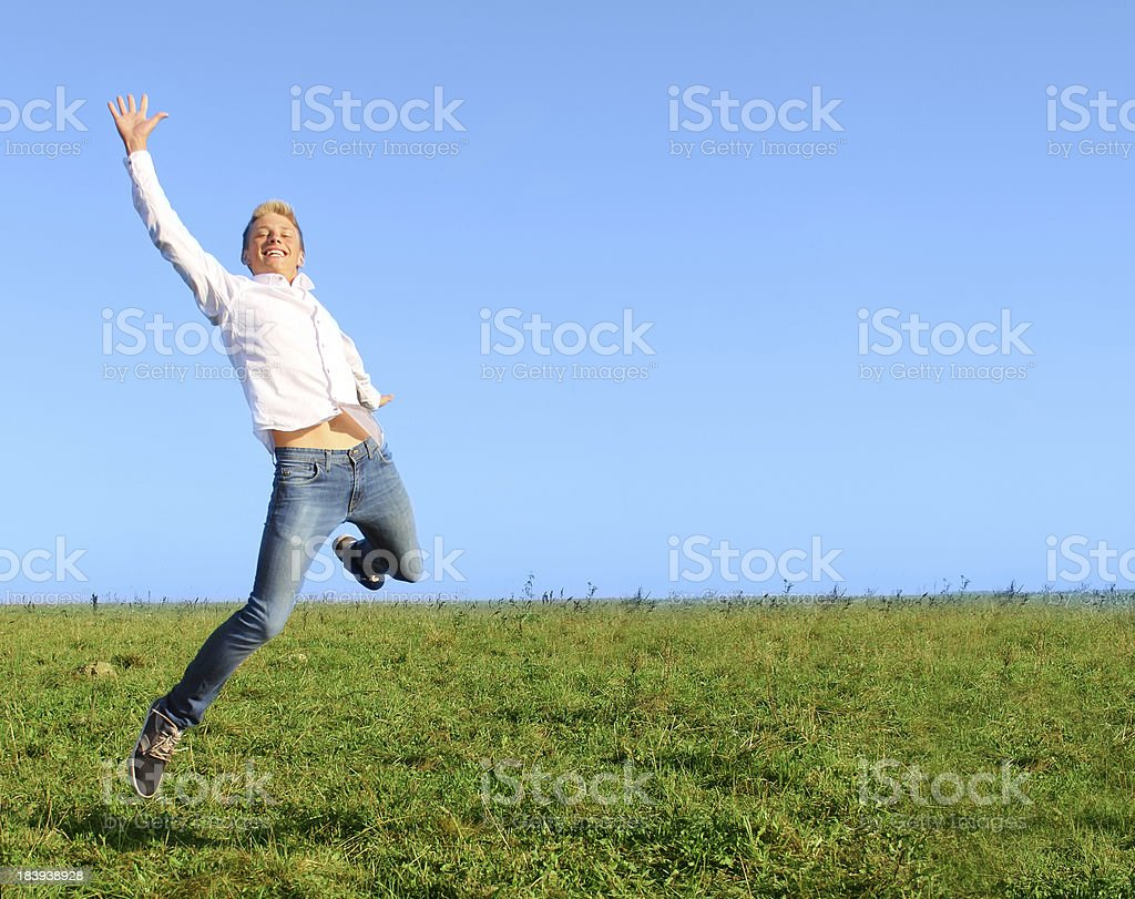 Man jumping on summer field royalty-free stock photo