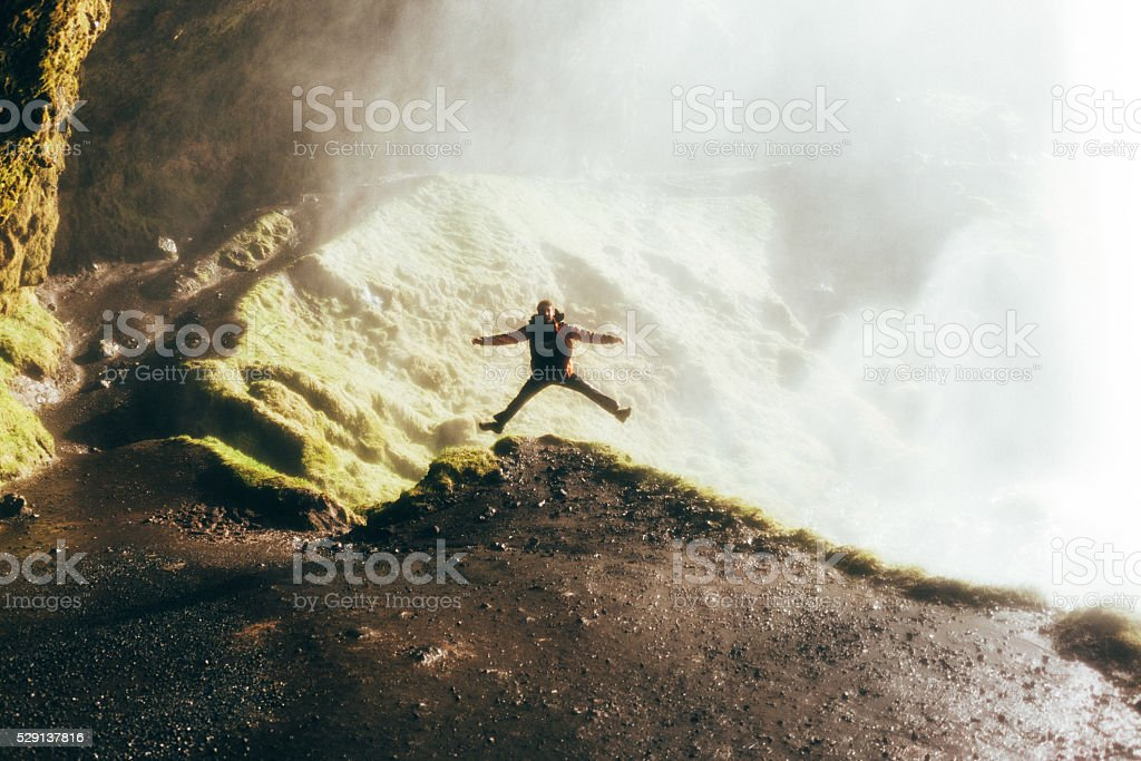 Man jumping on the hill stock photo