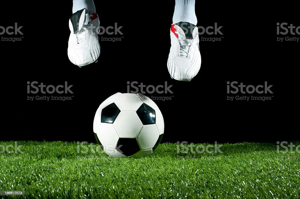 man jumping over a soccer ball royalty-free stock photo
