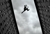 Man jumping over building