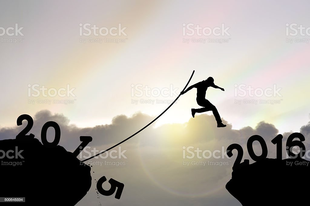 Man jumping over precipice stock photo