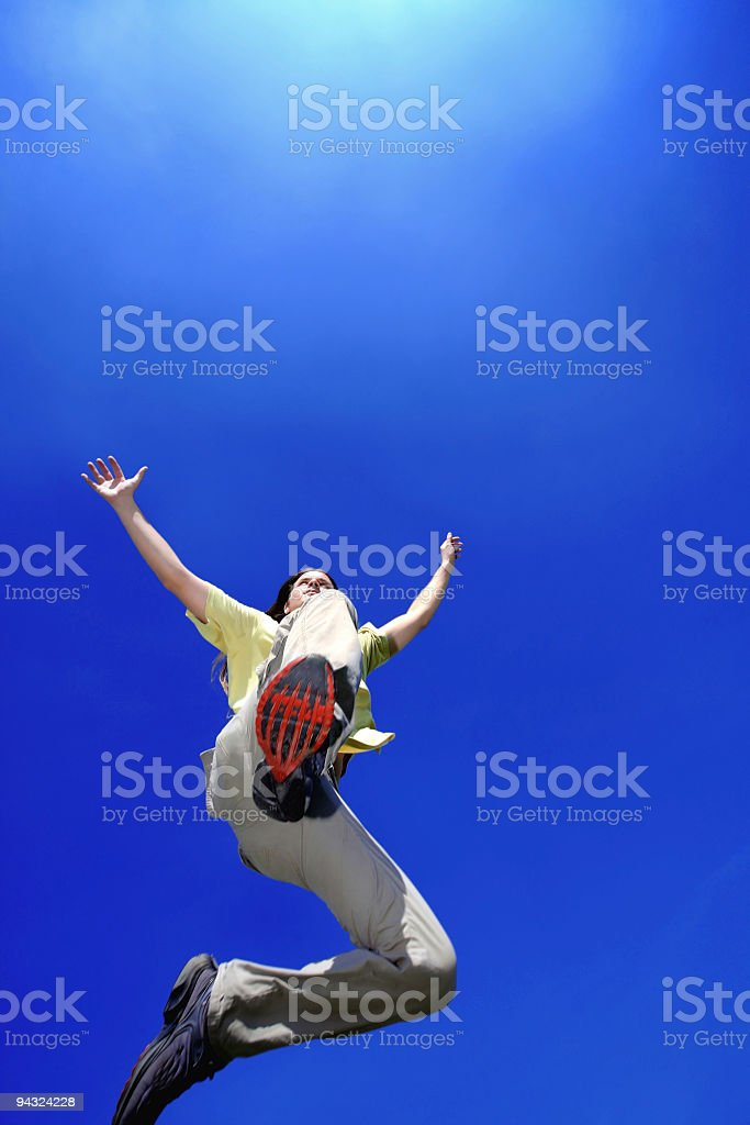 Man jumping to the light in sky stock photo