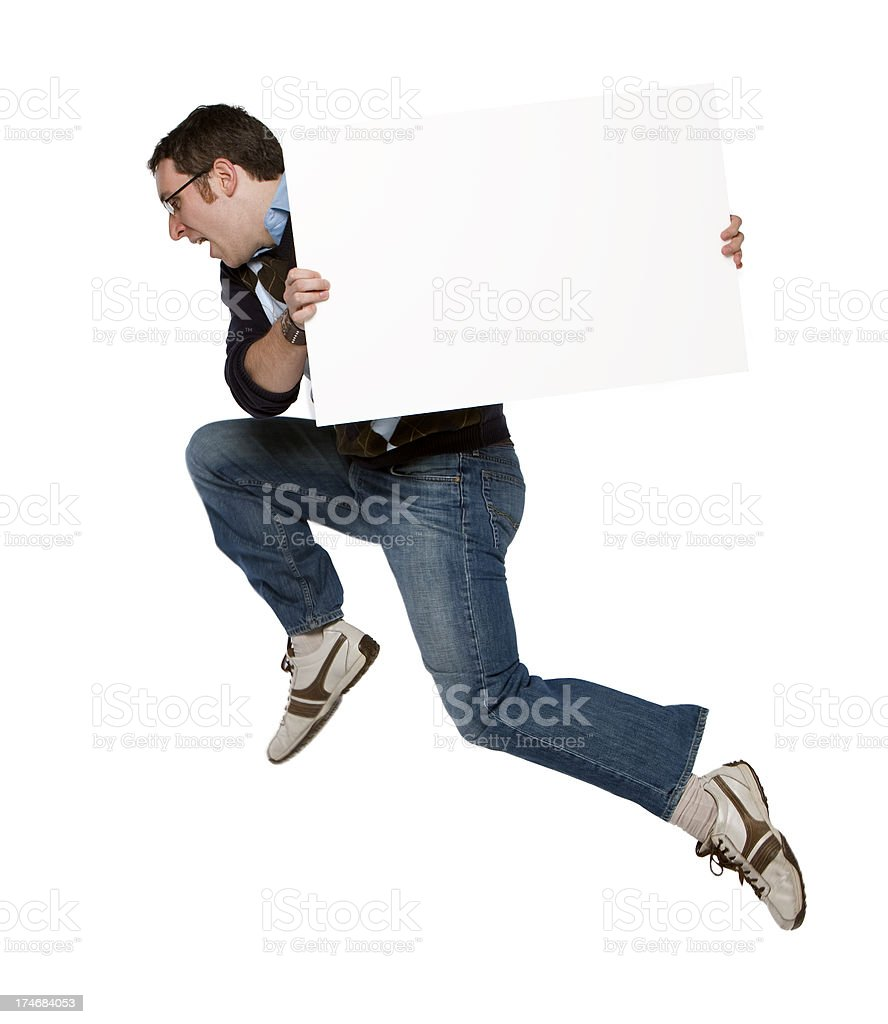 Man jumping with a blank sign stock photo