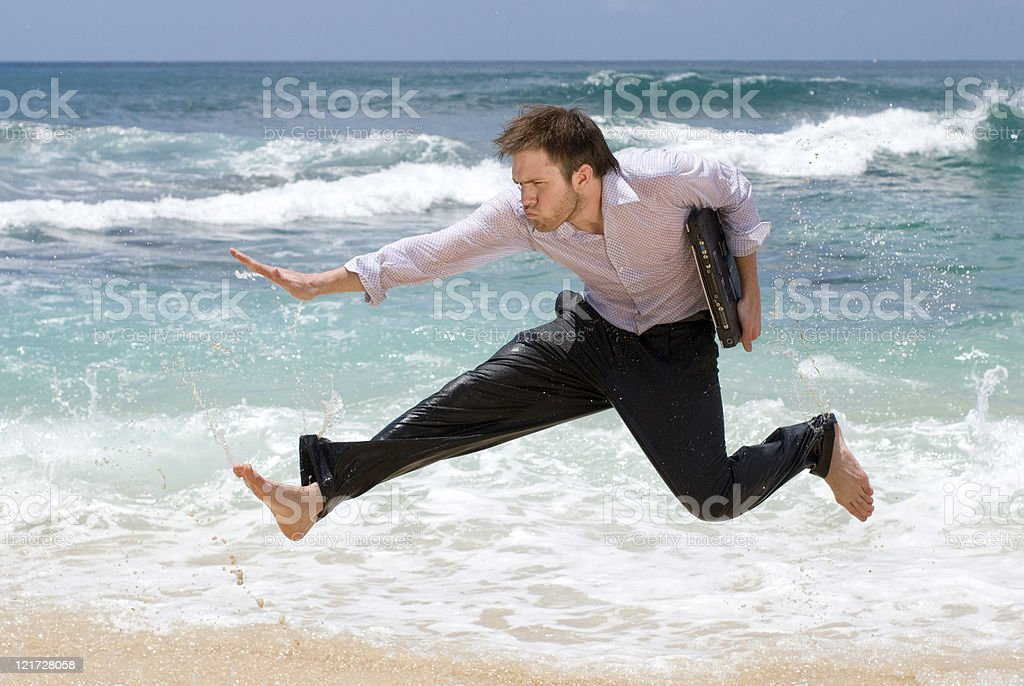 Man Jumping With a Laptop royalty-free stock photo