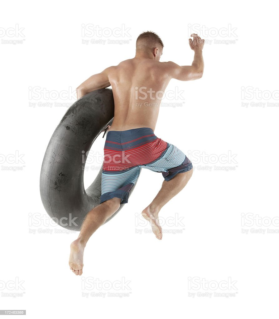 Man jumping with inner tube royalty-free stock photo