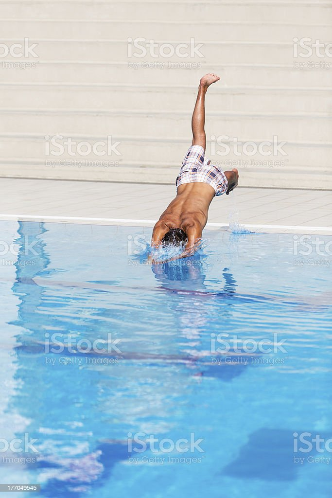 Man jumps into the swimming pool royalty-free stock photo