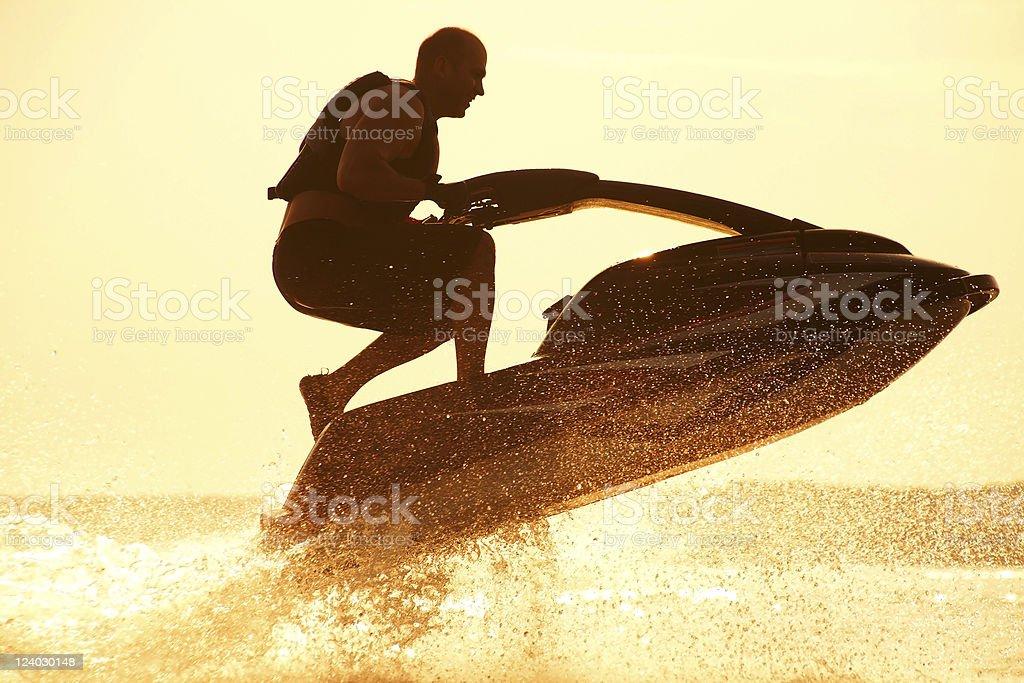 man jumps on the jetski stock photo
